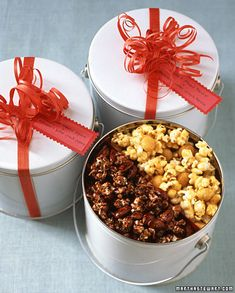 Popcorn Tins Pack two kinds of homemade flavored popcorn, such as our macadamia butter-crunch popcorn and chocolate-almond popcorn, in one popcorn tin. How to Make the Popcorn Tins Homemade Popcorn, Homemade Food Gifts, Flavored Popcorn, Edible Gifts, Homemade Christmas Gifts, Popcorn Tins, Popcorn Buckets, Christmas Diy, Christmas Popcorn