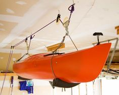 Discover 8 different kayak storage ideas. Includes 3 different types of kayak racks to wall-mounted options, ceiling storage systems and more. Plus a DIY video. Kayak Hanger, Kayak Rack, Garage Ceiling Storage, Entryway Storage, Closet Storage, Diy Kayak Storage, Storage Racks, Fishing Storage, Tool Storage