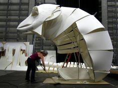 "Build process for ""Metsanhenki"", a large puppet in conjunction with the Helsinki Festival in Finland."
