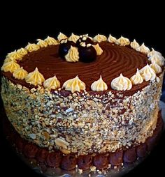 Peanut Butter Truffle Cake with peanut-butter butter-cream frosting topped with chocolate ganache and peanut butter truffles baked into the cake. Alexander's Chocolate Classics original.  309 E. Main S.  Dayton WA (509) 240-7531 http://www.alexanders-chocolate-classics.com