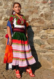 Michoacán woman wearing a traditional dress from her town. Mujer purépecha en Michoacán