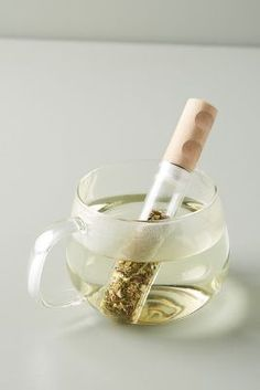 Brewing loose leaf tea has never been easier or more stylish, with the Kikkerland Tea Stick. Designed with aesthetics in mind, this sleek strainer is perfect for brewing your mom's favorite loose leaf tea. Kitchen Items, Kitchen Utensils, Kitchen Products, Unique Kitchen Gadgets, Kitchen Tools, Kitchen Cabinets, Kitchenware, Tableware, Tea Gifts