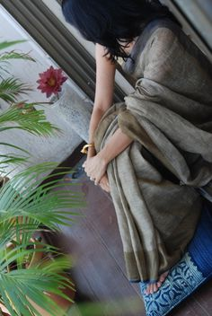 Gray Colour Jute Cotton Saree with blue and brown borders.