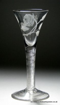 This is a rare variation of the Jacobite rose and you can see an exact duplicate of this style on page 121 plate 87 engraved upon the fabulous 'Health To All Our Friends' cordial glass within Geoffrey Seddons 'The Jacobites and their Drinking Glasses' http://scottishantiques.com/georgian-wine-glasses/jacobite-engraved?product_id=3768#.Vg2aocZ2lTM