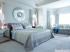 Shimmery blue room. Design: Tobi Fairley. housebeautiful.com. #blue #glamorous #bedroom #silk_satin_headboard