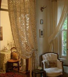 Antique lace curtains hung from interior doorways