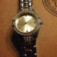 Guess watch This is a Guess watch with diamonds for numbers 3, 6, 9 and 12. It needs a new battery ?? Guess Accessories Watches
