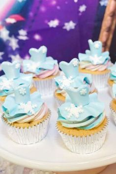 Don't miss this pretty Frozen birthday party! The Elsa dress cupcakes are so fantastic! See more party ideas and share yours at CatchMyParty.com   #catchmyparty  #partyideas #frozen #frozen2 #frozenparty #princessparty