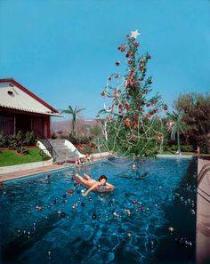 Slim Aarons, Christmas Swim, c. 1954, C-Print. Rita Aarons and kids at their Hollywood Hills home.