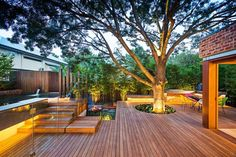 I love how the tree is incorporated into the deck