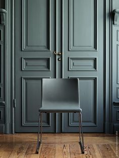 grey panelled door, modern chair - think about using same colours on furniture and walls...