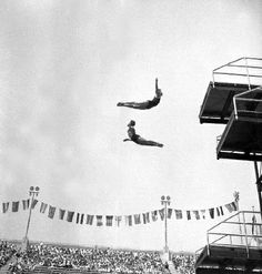 Frank Kurtz of the United States and Farid Samaika of Egypt do an exhibition dive from the high platform in Los Angeles, 1932. Bettman/Corbis.