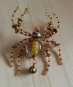 Beautiful glass focal bead on this beaded spider brooch