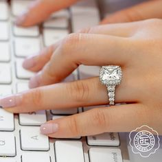 Channels of graduating diamonds curve into the ceiling of this distinctive engagement ring, featuring two rows of blooming diamonds to enhance the princess-cut center diamond. Tacori RoyalT Style # HT2624PR9