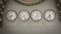 clocks on a wall with time zone of different country. Christians room