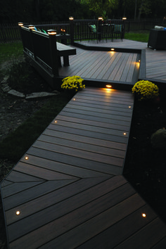 Light the night for you and your guests with TimberTech Decking and Lighting. This deck is from our Legacy Collection in Tigerwood with Mocha accents. #timbertechdeck #timbertechlighting #mytimbertech