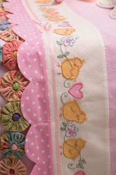 Adorable trim for a pillowcase. Notice the yo-yo edge trimmed in pom pom's!