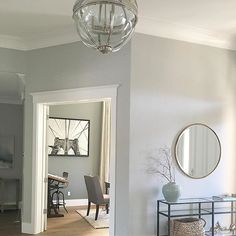 {paint color in entry is Dolphin Fin by Behr//office is Amherst Gray by Ben Moore}
