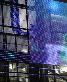 Transparent Media Facade IMAGIC WEAVE®. The LED profiles are attached to the reverse side of the HAVER Architectural Wire Mesh maintaining the homogenous look of the façade at all times. This unique transparent media façade system can transform airport buildings, stadiums, shopping malls, skyscrapers and other large buildings into exciting transparent canvases for vibrant, large-scale communication.