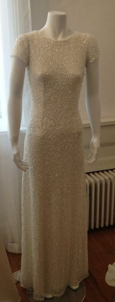 Obsessed with this ultra-glam David's Bridal gown with all-over paillettes
