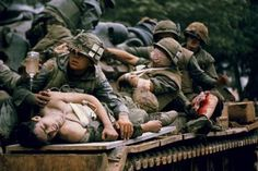 Wounded American troops being transported via tank to the rear for further medical attention during the Battle of Hue in South Vietnam, February 1968.