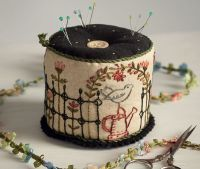 One of the prettiest pincushions we've seen! Designed by Kathy Schmitz.