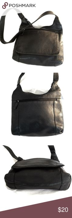 "Black Leather Tignanello Shoulder Bag Very gently used, this black pebbled leather purse shows little wear in exterior and interior is in fair shape. Measures 12"" across the bottom, 10"" tall, 2 1/2"" deep at bottom. Shoulder strap drop is 17"". Tignanello Bags Shoulder Bags"