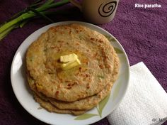 Rice Paratha: 1 cup wheat flour, Water as required; For filling: 1 cup cooked rice, 1/4 cup Chana dal boiled, 1 scallion chopped, 1 tsp ginger grated, Salt to taste, ½ tsp cumin seeds, ½ tsp garam masala