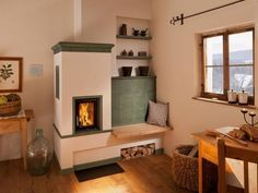 masonry stove , I want one similar to this in my house but with a longer bench and cooking facilities. Deco Champetre, Stove Fireplace, Rocket Stoves, Style Tile, My Dream Home, Sweet Home, New Homes, Construction, House Design