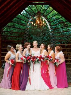 Bright & Beautiful Avalon Legacy Ranch Wedding. Vintage from Rent My Dust.  Photos by Jessica Gold Photography.  Gorgeous bridesmaid dresses in all bright colors, pink, red, maroon, fuchsia, & purple.  Bridesmaid flowers from Rlove Floral