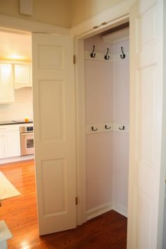 Hooks in the front closet for coats and bags. This would work so much better than the hanging rod we have now in our oddly shaped front closet! Better use of space
