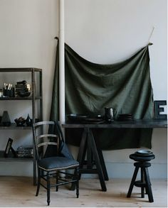 Interesting idea, using draped cloth as a focal point in a room.