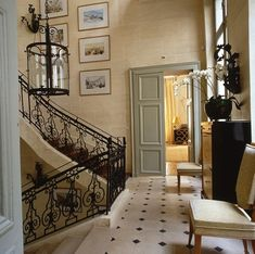 Incredibly beautiful!  Ironwork design, gorgeous paint color on gracious doors, warm-toned walls, fab floors- love!  via Flickr