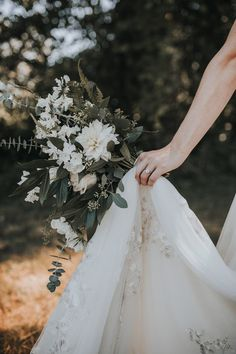We love this shot that highlights this bride's stunning ring and earthy bouquet | Image by Blush Photography #floralldesign #weddingring #engagementring #diamondring #bridalbouquet #bridalaccessories #earthyweddinginspo #weddingphotography #bridalfashion #bride #earthybouquet #weddingflowers