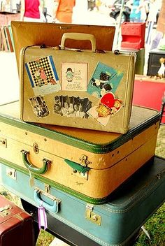 sooo many ways to use vintage suitcases......storage for my red-work linens....craft supplies...one of my favourite: make little dog beds.....