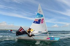 Slingsby waves the flag as he revels in his gold medal.