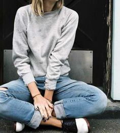 laid-back outfit: grey sweatshirt, rolled-up jeans, and a pair of colorblock loafers