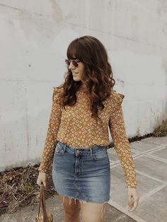 Get this look: http://lb.nu/look/8853125 More looks by Tonya S.: http://lb.nu/themoptop Items in this look: Forever 21 Ruffled Floral Top, Frayed Denim Mini Skirt #minimal #vintage #boho #bohemian #fall #fallstyle #floral