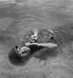 Stock Photography, Royalty-Free Photos & The Latest News Pictures Ww2 Pictures, Iwo Jima, Man Of War, Floating In Water, Vietnam War, World War Two, Royalty Free Photos, Wwii, Horror