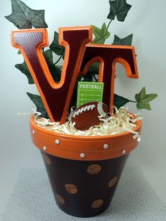 handmade football centerpiece, esp if you have a table or twelve of VT friends Cheer Banquet, Football Banquet, Football Cheer, Football Tailgate, Football Favors, Football Stuff, Football Season, Tailgating, College Football