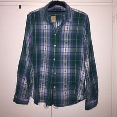 Turquoise plaid flannel shirt Turquoise/lavender flannel plaid button front long sleeve shirt. Brand new! American Eagle Outfitters Tops Button Down Shirts