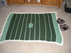 """Evan's little cousin - Grant - his daddy asked for a baby blanket that was a football field.  So here it is, with their own """"team"""" logo.  A football themed diaper cover and hat completed the set for the newborn due March 2014."""