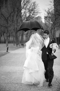 Rain on your wedding day? We think it's fabulous. Photography by Cristina G Photography / cristinagphoto.com, Floral Design by Fleur De Lis / fleurdelischicago.com/chicago-wedding-florist.php