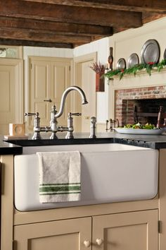 The storage-packed peninsula allows the cook to take charge of prep and cleanup while conversing with guests. | Sink: Shaws, @rohlfaucets | Faucet: @moen | Photo: John Gruen                                                                                                                                                                                 More