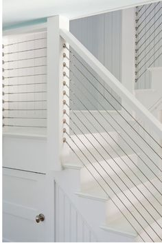 horizontal cable stair railings from Lauren Liess' Lake House Update - interesting, doesn't obstruct view, nautical-ish - no purpose, just pinning bc they're cool and in case we need in future