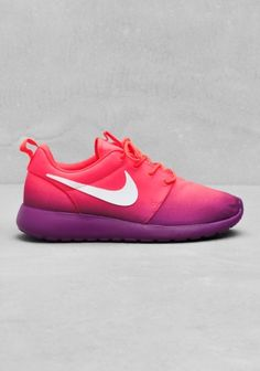 NIKE These sneakers have a basic shoe design coupled with colourful upper that resembles a tropical sunset. - Waffle design on the outsole provides good traction- Collar of the shoe is cushioned for comfort and ankle protection- EVA foam outsole