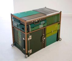 Michael Johansson green vintage suitcases |