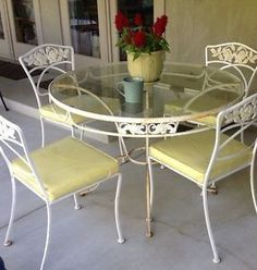Wrought Iron Patio Table And 4 Chairs wrought iron table, 4 chairs, cushions. woodard. grapes leaves