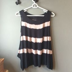 Guess muscle tank Get ready for summer with this Striped black muscle tank by Guess. Super soft 100% modal. In perfect, like new condition. Guess Tops Tank Tops