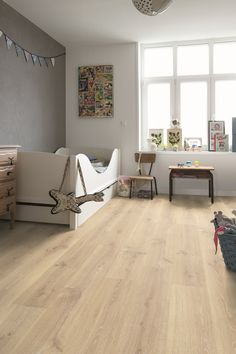 Quick-Step Laminate Flooring -Creo 'Tennessee oak light wood' (CR3179) in a modern nursery. To find more nursery inspiration, visit our website: https://www.quick-step.co.uk/en-gb/room-types/choose-the-perfect-nursery-flooring #garderie #kinderkamer